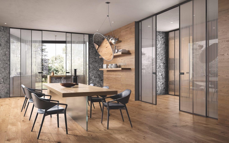 Parete Divisoria Con Porta Scorrevole dividere soggiorno e cucina con le porte scorrevoli in vetro